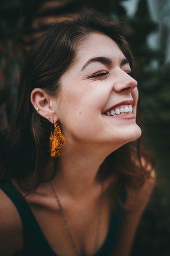 girl with beautiful skin smiling